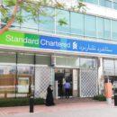 standard chartered jobs cut